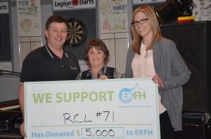 RCL #71 President Ken Carlow presents a gift to EKFH's Donna Grainger and Cassandra Schwarz, Executive Director