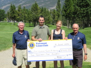 Lions members Mike Tanguay, President ({left) and Norbert Schab (right) present $2,500 to EKFH's Cassandra Schwarz, Executive Director & Rob Venier, Board of Directors